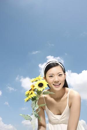 Woman holding sunflowers Stock Photo - 4197522