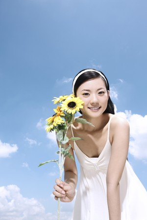 Woman holding sunflowers photo