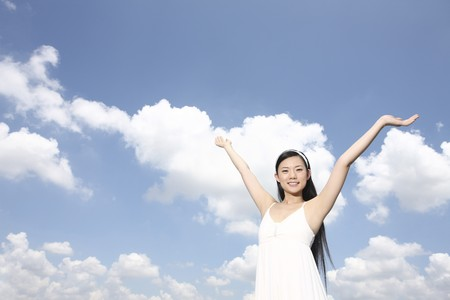 extending: Woman extending arms in the air