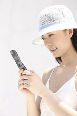 Woman with hat text messaging Stock Photo - 4197398