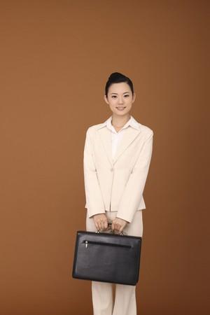 Businesswoman holding briefcase photo