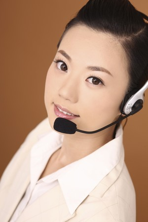 Businesswoman with headset looking at camera photo