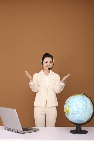 Businesswoman with headset extending both arms photo