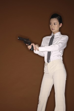 Businesswoman holding a gun photo