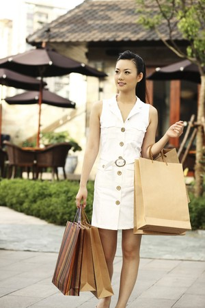 contentment: Woman with shopping bags
