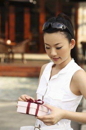 Woman holding gift box photo