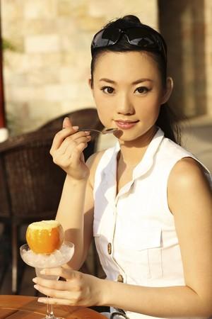 Woman enjoying drink after shopping Stock Photo - 4197590