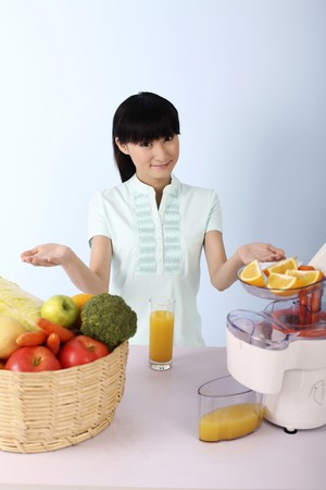 Woman showing her preparation to make fruits and vegetables juice photo