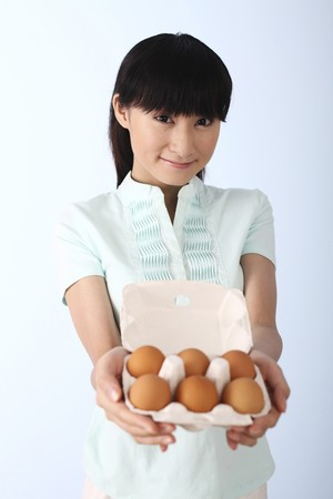 Woman with a tray of eggs photo