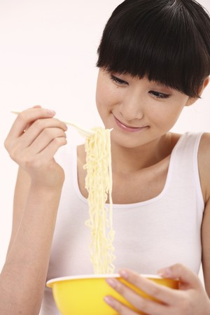 eating noodles: Woman eating noodles Stock Photo
