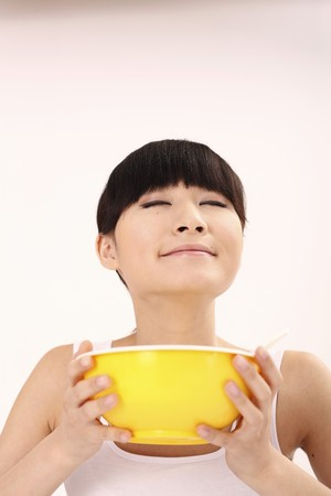 Woman enjoying the smell of instant noodles photo
