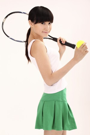 Woman with tennis racquet and tennis ball Stock Photo - 4197453