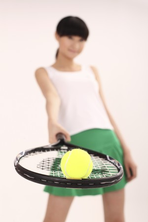 Woman with tennis racquet and tennis ball photo