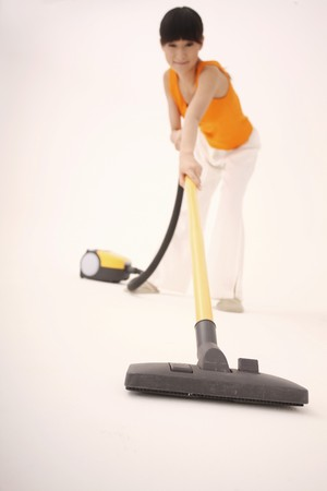 Woman vacuuming the floor photo