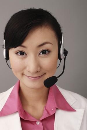 Businesswoman with telephone headset Stock Photo - 4197513