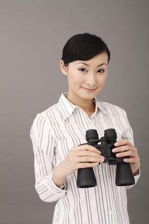 Businesswoman holding binoculars Stock Photo - 4197639