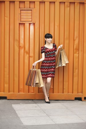Woman carrying paperbags photo