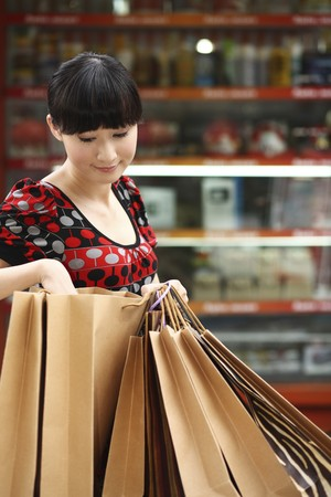 Woman looking inside paperbag Stock Photo - 4197649