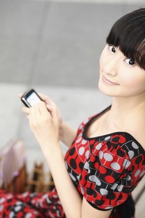 Woman using PDA phone Stock Photo - 4197588