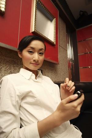 Businesswoman using PDA phone Stock Photo - 4197554