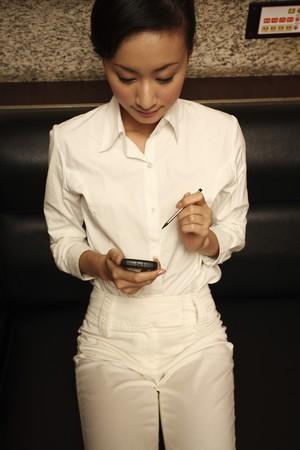 Businesswoman using PDA phone Stock Photo - 4197520