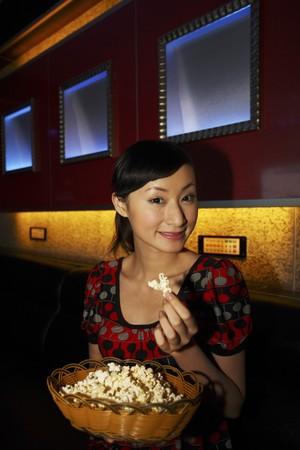 Woman enjoying popcorn photo