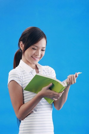 revision book: Woman reading book Stock Photo
