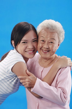 Woman and senior woman embracing each other