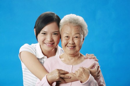 Woman hugging senior woman from the back Stock Photo - 4197511