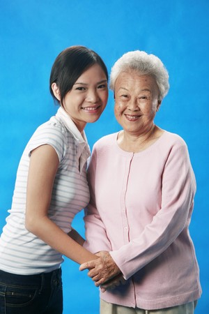 grandparent: Woman and senior woman holding hands