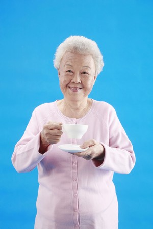 Senior woman with a cup of coffee Stock Photo - 4197497