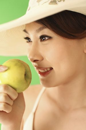 Woman holding a green apple, smiling Stock Photo - 4630314