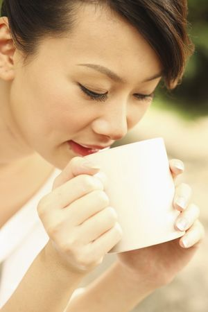 Woman enjoying a cup of tea Stock Photo - 4630278