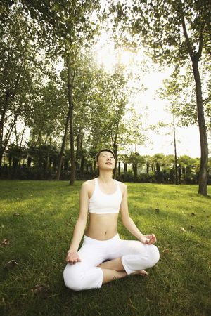 Woman meditating with her eyes closed photo