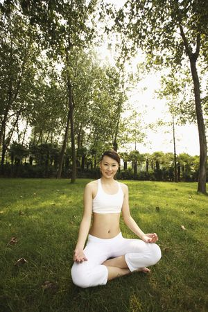 Woman in lotus position, smiling photo