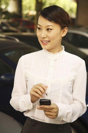 Woman using PDA phone Stock Photo - 4630196