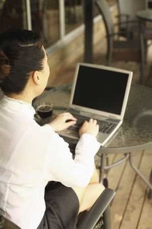 Woman using laptop in a cafe Stock Photo - 4630208