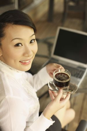 Woman holding a cup of coffee, smiling Stock Photo - 4630279