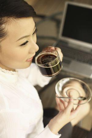 Woman enjoying a cup of coffee Stock Photo - 4630271