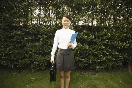 Woman holding folder and briefcase photo