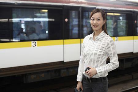 Woman on train station platform Stock Photo - 4630177