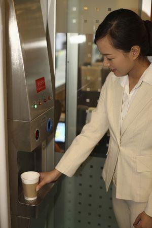 Woman taking hot water photo