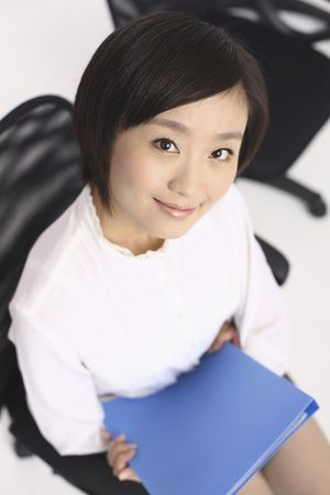 Woman sitting on chair holding file photo