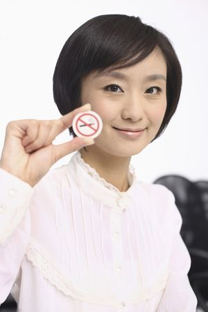Woman holding a no smoking sign photo