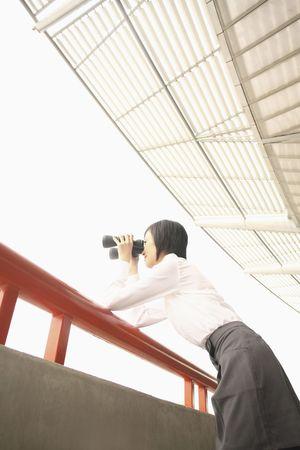 Woman using binoculars photo