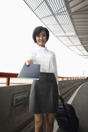 Woman with suitcase showing passport Stock Photo - 4630895