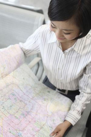 Woman reading map photo
