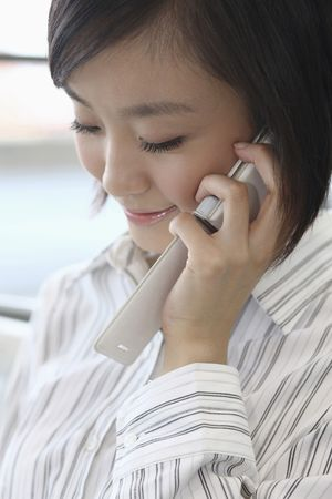 Woman talking on the phone, smiling Stock Photo - 4630974