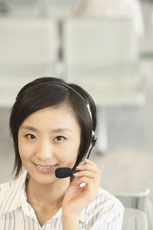 Woman talking on telephone headset photo