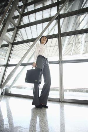 Woman carrying bag Stock Photo - 4631000